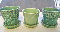 Vintage McCoy little pots & saucers sold at More Than McCoy on TIAS.