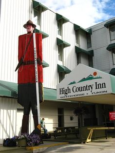 "The High Country Inn in Whitehorse, Yukon has a 40 foot high ""mountie,"" based on a tv character, that greets its guests. This guide2travel article has video clips from the '50s tv show titled Sergeant Preston of the Yukon, as well as an original soundtrack of the theme song it used."