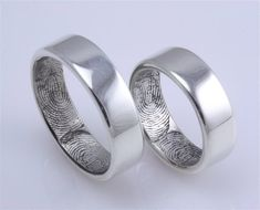 Love this idea for wedding bands - matching rings with your partner's fingerprint inside. The wedding date could be engraved on the blank space inside and both partners' intials could be engraved on the outside. Unique, original, and very intimate :) White gold or platinum....no diamonds. Yayah babay!