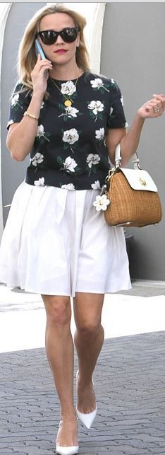 Who made  Reese Witherspoon's blue floral top, white pumps, and tan woven handbag?