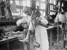 Making an artificial leg for a wounded serviceman at Roehampton Hospital in Surrey. 1917.
