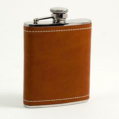 Saddle Brown Leather & White Stitch Flask  - Sip in style with this leather flask. Constructed from stainless steel and wrapped in genuine saddle brown leather with white cross-stitching, this handsome flask was designed for the fashionable man on the go. The flask holds up to 6 ounces of liquid and features a captive cap and durable rubber seal.