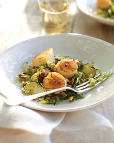 We can't think of a more elegant supper than these seared scallops on a bed of roasted brussels sprouts. A zingy hazelnut vinaigrette ties all the flavors together beautifully.