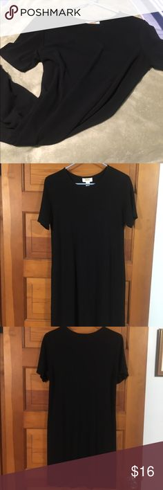 Pretty black simple dress This talbot black dress is size medium dress and a must for every woman's closet. Dress it up with jewelry and a jacket  or go simple with a cardigan sweater. Just slip over your head ( no zipper) and you are all ready. Talbots Dresses Midi