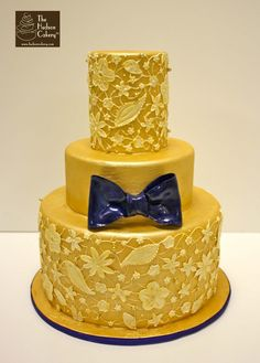Hudsoncakery.com gold navy piped lace wedding cake