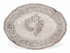 An Italian rococo silver glove tray, mark of CCG(?), and an indistinct mark.