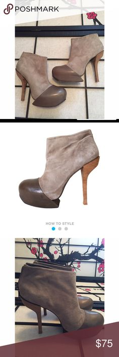 BCBG MAXAZRIA Grey Leather 'DIVA' Booties These heels are so rad and can be dressed up or down! Only wear is on the bottoms as shown! Heels measure 6in. Unzips in the back so they are easily put on. Top part is suede. Actual heels in fabulous condition! BCBGMaxAzria Shoes Platforms