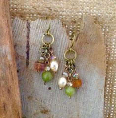 Beautiful Artisan designed and crafted dangle earrings. A great earthy look made with natural Carnelian, Jade and Freshwater pearl beads, topped with crystals and tied into individual charms. The charms dangle from hammered handmade ear wires. They will go well with Boho, Southwest or Hippie styles.  Earrings measure 1 3/4 from top of hook and charm alone measures 1 1/4.  Drawstring gift bag included with purchase.  1.99 Shipping on all jewelry.  PLEASE visit & LIKE my Facebook Page…