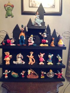 Castle display shelves for Vinylmation and Infinity figures, plus a lot of other items. Each piece is handmade to order. Quality wood always