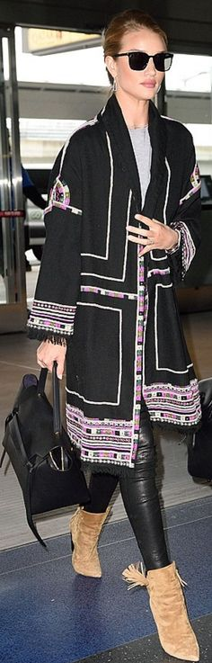 Who made  Rosie Huntington-Whiteley's black handbag, jewelry, brown suede tassel boots, sunglasses, and fringe print coat?