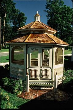 The perfect Gazebo for these Fall months! Our Queen Ann garden house features a double tiered roof, window screen inserts and screened front door. 15' pictured with optional white stain. Shipped kit. Motor freight.