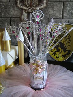 Princess and Knight  Birthday Party to Go Box. Princess Party Tutus, Tiaras, Sparkling Wands, Inflatable Knight Shields and Swords. Party also includes Plush Dragon Craft with our special Princess and Knight Party Games and Activities Guide.