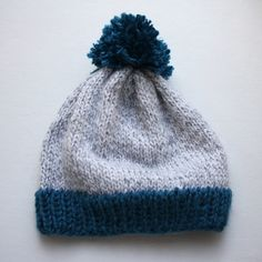 Free Knitting Pattern - Big Pom Baby Beanie - size up for adult, then make it all navy blue with a small gray stripe a few rows above the rim Baby Hat Knitting Pattern, Baby Hats Knitting, Crochet Baby Hats, Knitting For Kids, Knit Or Crochet, Knitting Patterns Free, Knit Patterns, Free Knitting, Knitted Hats