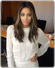 Smooth make up and dark hair with blonde highlights really flatter your look.