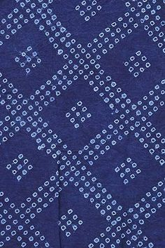 Japanese Shibori Fabric: Large Diamond. This indigo-dyed shibori cotton fabric is hand-stitched and dyed in Japan.  This type of stitched resist  is achieved by first drawing the outline of the pattern on the cloth, hand-stitching with needle and thread following the outline, pulling the thread tightly to create a resist for the pattern, and then dipping the cloth into the indigo dye vat multiple times to achieve the deep blue color. | Clothroads