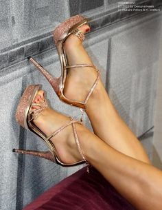 Glitter bronze high heels sandals with platform and sexy red nailed feet