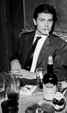 longtallsallyd: Alain Delon at a club in Paris, 1965.