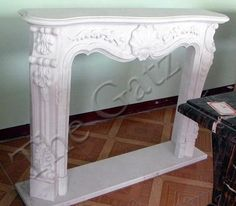 thegatz - Marble Fireplace Mantel with Classic Floral Carvings, $2,300.00 (http://www.thegatz.com/classic-florally-designed-marble-fireplace-mantel/)