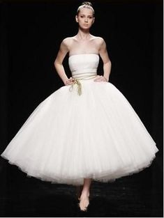 Strapless tea length ballerina style wedding in layers of tulled skirt. Processing TimeStandard processingtime is approx 8 weeks, peak season may be longer.