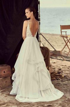 2c4c265ec03 View Layered Tulle Skirt Wedding Dress - Style from Mikaella Bridal.  V-neckline lace bodice lined with Nude Tulle.
