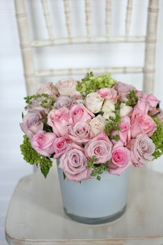 Like a summer garden in full bloom, several varieties of pink roses and are accented with mojito hydrangea and blooming oregano. Floral design: Winston Flowers.