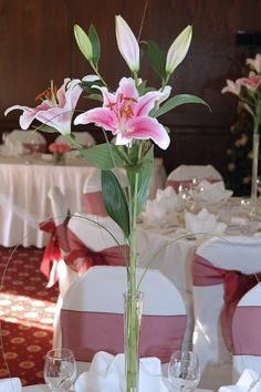 Stargazer lilies in tall vases made for a unique center piece.