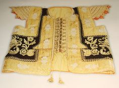 """Traditional Tunisian vest called """"farmla"""". It is a part of a female wedding dress. There is a lot of gold embroidery and a lacing at the front"""