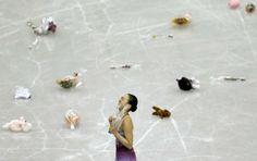 Asada of Japan reacts after performing during women's short programme at ISU Grand Prix of Figure Skating Final in Fukuoka