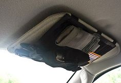 Seems like a good way to keep basic emergency items on hand in the vehicle. MOLLE Visor Panel