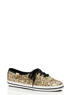 I Want from Kate Spade!!!  to make our glitter sneakers, we took a classic-looking tennis shoe and added a heaping dose of sparkle. the result? a rubber-soled lace-up that's equally suited to the sidewalk and the dance floor.