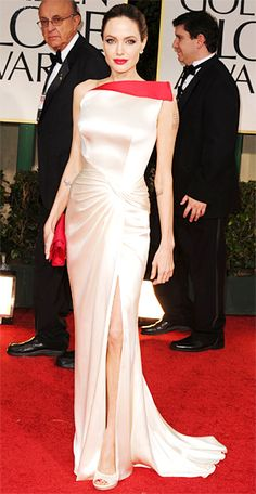 Angelina Jolie in a gown by Atelier Versace. A custom pair of Lorraine Schwartz…