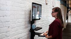The StandCrafted minimalist, modular, wall-mounted standing desk in black high density industrial grade thermoplastic