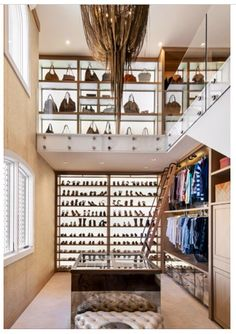 Open closet in main bedroom could have a wall for bags and shoes with lighting from the back to make it a 'wow' feature.