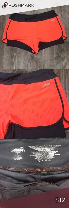 """Avia Athletic Running Yoga Shorts Gray Neon L Avia running shorts. Gray spandex feel lining underneath. Top is bright neon coral/orange color. Large. Measures 17"""" across Waist, 12 1/2"""" length. Avia Shorts"""