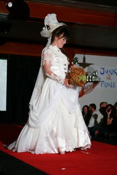 """""""3 Story Funktorian"""" by Cathy Mullins. Old wedding gowns, text tubing, toilet tissue and old bobbles. Featured in the 2012 Junk2Funk Eco-Fashion show, a benefit of the Kootenai Environmental Alliance that showcases the runway outfits made from recycled materials by local artists."""