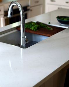 I have been looking for the perfect kitchen counter top and with 3 kids, a marble Carrera counter is just not an option. It stains and alwa. Custom Woodworking, Woodworking Projects Plans, Teds Woodworking, Frosty Carrina Caesarstone, Stone Benchtop, Inset Sink, Diy Cutting Board, Kitchen Reno, Kitchen Ideas
