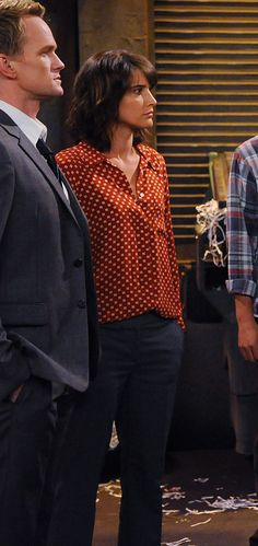 Robin's orange and white blouse and work style on How I met your mother