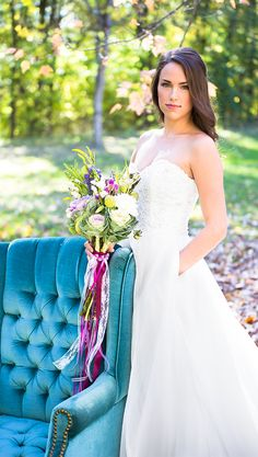Kennedy Blue Carolyn has a beautiful lace bodice with a strapless, sweetheart cut neckline with scalloped edging, and a natural waistline. The flowing A-line skirt is made of luxurious organza fabric and complete with side pockets and a chapel length train.