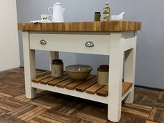 Freestanding Kitchen Island fitted with an 80mm thick butcher's block oak worktop. Features a useful full width drawer mounted on soft close runners & a slatted oak lower storage shelf. Shown here finished in Little Greene 'Clay Mid' but be hand painted in any other colour. Size shown is W:1200mm H:910mm D:620mm & paint colour is Little Greene Clay Mid. Shelves, Freestanding Kitchen Island, Workstation, Freestanding Kitchen, Painted Kitchen Island, Home Decor, Kitchen, Storage Shelves, Medium Kitchen