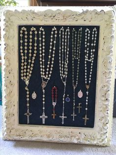 Collection of my rosaries and the memories of many graces received while praying. I used foam core board, covered it with scrap book paper, and pinned the rosaries on. Easy to remove the rosaries whenever I want to use one.