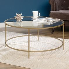 Glamorize your living room with this modern round coffee table from Sauder Woodworking, featuring a luxurious gold finish. Copper Coffee Table, Round Coffee Table Modern, Round Glass Coffee Table, Cool Coffee Tables, Glass Table, My Living Room, Living Room Furniture, Modern Furniture, Studio Living