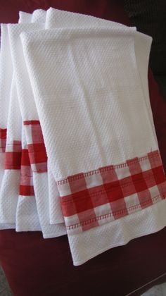 Gingham sewed to cheap WalMart kitchen towels to decorate them.