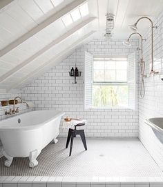 Amazing bathroom makeover❣ Follow the link to see the before image—the eave was opened up, the window enlarged, and a claw-foot tub replaced the old built-in tub  toilet (probably moved)❣