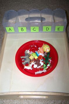 Sort objects into letter boxes by beginning sounds