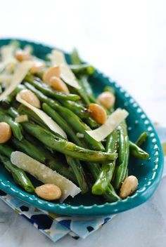 Grilled Green Beans with Marcona Almonds - Part salad, part side dish, 100% summer. Grilled green beans topped with Marcona almonds, Parmesan cheese and Orange-Shallot Dressing. | foxeslovelemons.com