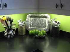 More pics of this kitchen on link: Our Apple Green Kitchen, Apple Green is the best description of our new kitchen wall color. With white cabinets and black countertops, the pop of color works for us. Hope you like it!, Kitchens Design