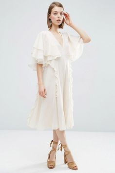 Pens down, there are new ins at ASOS. Our go-to fast fashion retailer has a host of pretty styles just in, proving you don't need to ditch the florals, pinks and white come autumn – rather, just give them a seasonal update. This means maxi dresses in blush and burgundy, an abundance of ruffles on just about everything, plus stylish black pieces to add to your repertoire, from semi-transparent tops to cold shoulder evening pieces.