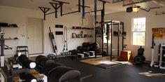 This is awesome! Things I want in my dream home gym: Treadmill, Yoga mats, TV, DVDs, wall mirrors, hand weights, pull up bar(s), TRX bands, squat station, chest press bench and weights, Ugi ball, kettleballs, boxes, punching bags and gloves, jump ropes, medicine balls, and an ab roller.