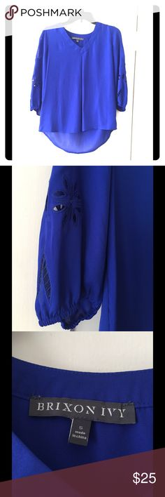 Elmar Embroidered Cutout Blouse Beautiful in blue! This gorgeous top is not only a stunning sapphire hue, but the delicate cutouts along the sleeves offer a unique element, making you feel smart and chic! 3/4 capped sleeves, fits loose and flowy, so it's perfect with skinny jeans or tailored slacks. Worn once. 100% polyester. Brixon Ivy Tops Blouses