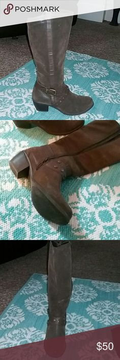 Just to the knee boots Man-made materials,feels and looks like a brushed suede,worn only once,side zipper,very comfortable.looks like a cowboy boot. Shoes Heeled Boots